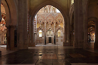 Fluted intertwined arches in the Villaviciosa Chapel, built under Alfonso X in the 13th century, adjoining the hypostyle prayer hall, area built under Prince Abd Al-Rahman II, begun 832, in the Cathedral-Great Mosque of Cordoba, in Cordoba, Andalusia, Southern Spain. This chapel served as the sanctuary until the 16th century cathedral was built. The first church built here by the Visigoths in the 7th century was split in half by the Moors, becoming half church, half mosque. In 784, the Great Mosque of Cordoba was begun in its place and developed over 200 years, but in 1236 it was converted into a catholic church, with a Renaissance cathedral nave built in the 16th century. The historic centre of Cordoba is listed as a UNESCO World Heritage Site. Picture by Manuel Cohen