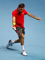 Roger Federer (SUI) (1) against Robin Soderling (SWE) (4) in their Group B  match. Roger Federer beat Robin Soderling 7-6 6-3 ..International Tennis - Barclays ATP World Tour Finals - O2 Arena - London - Day 5 - Thu 25 Nov 2010..© Frey - AMN Images, Level 1, Barry House, 20-22 Worple Road, London, SW19 4DH.Tel - +44 208 947 0100.Email - Mfrey@advantagemedianet.com.Web - www.amnimages.photshelter.com