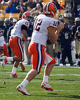 Syracuse quarterback Ryan Nassib (12) eyes wide receiver Alec Lemon (15). The Pittsburgh Panthers beat the Syracuse Orange 33-20 at Heinz Field in Pittsburgh, Pennsylvania on December 3, 2011