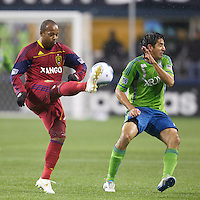 Real Salt Lake midfielder Andy Williams clears the ball over Seattle Sounders FC defender Leonardo Gonzalez during play in a Major League Soccer Wester Conference Semifinal match at CenturyLink Field in Seattle Wednesday November 2, 2011. The Sounders won the match 2-0, but lost the series.