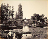 BNPS.co.uk (01202 558833)<br /> Pic: DominicWinter/BNPS<br /> <br /> Bridge near Srinuggur, built by Akbar.<br /> <br /> Fascinating 150 year-old photographs of India taken in the aftermath of the failed mutiny have sold for almost &pound;8,000 at auction.<br /> <br /> The images, which date from 1863 to 1870, capture native soldiers with their weapons and picturesque landscapes and were taken by celebrated 19th century photographer Samuel Bourne.<br /> <br /> They went for a hammer price of &pound;6,400 to a private collector from America who bid online with extra fees pushing the overall price above &pound;7,800.<br /> <br /> Together with Charles Shepherd, Bourne set up photo studio Bourne &amp; Shepherd first in Simla in 1863 and later in Calcutta.