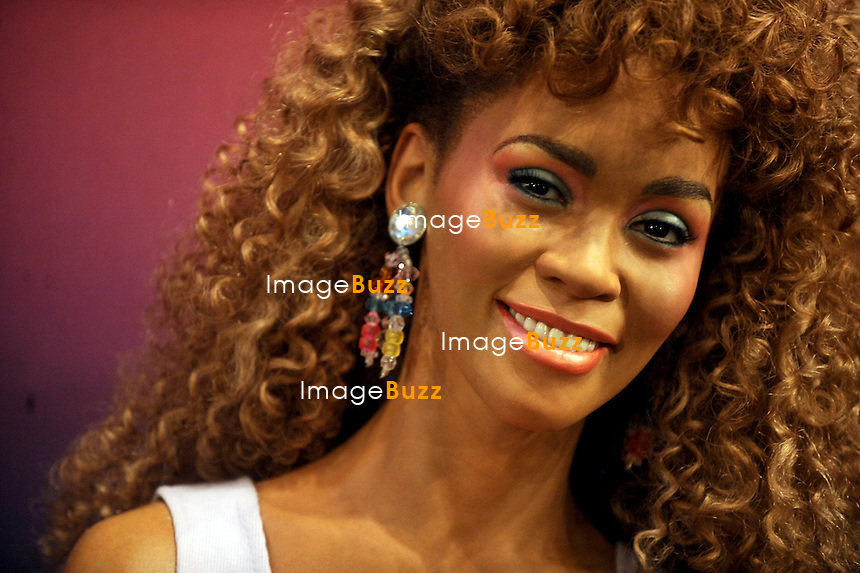 """WHITNEY HOUSTON'S WAX FIGURES UNVEILED /Madame Tussauds has created four wax figures in honor of the superstar, which immortalize iconic moments from the singer's 30-year career..The wax statues were officially unveiled with Cissy Houston ( Whitney's mother ) in New York today ( February 7 ) and will be placed in different locations across the country. The first wax figure features Whitney at the 1991 Super Bowl where she sang the national anthem, and will be sent to Washington, D.C. A recreation of a 2009 photo shoot from her final studio album will be on display in New York..Another figure remembers Whitney in The Bodyguard and will be put on display in Hollywood., while the fourth statue highlights her iconic look from her '80s hit """"I Wanna Dance with Somebody"""" and is heading to Las Vegas. New York City, February 7, 2013"""