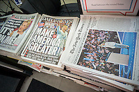Headlines of New York newspapers on Friday July 29, 2016 report on Hillary Clinton being nominated at the Democratic National Convention to be their presidential candidate. Clinton is the first woman from a major party to be the nominee for president.  (© Richard B. Levine)
