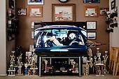 PHOENIX, ARIZONA, USA, 10/2016:<br /> Puchary zdobyte prze Dana Olszewskiego stoja obok  wlaczonego telewizora w jego salonie. Dan jest kierowca rajdowym i  od dziesiecioleci bierze udzial w wyscigach prywatnych samochow na torze &quot;Tucson Dragway&quot;<br /> Fot: Piotr Malecki / Napo Images****<br /> PHOENIX, ARIZONA, USA, OCTOBER 2016:<br /> Car racing trophies belonging to Dan Olszewski are standing next the tv set showing a commercial. Olszewski is a hero of vintage car racing, who ofter races at at the Tucson Dragway. Cars from 50's, 60's, 70's and 80's owned mainly by well off pensioners, beneficiaries of the previously generous American pension system - older white Americans. They compete to make a one mile straight strip road as fast as possible. The powerful custom engines have 500, 600, or even 700 horsepower.<br /> (Photo by Piotr Malecki / Napo Images)