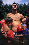 Members of the Bapiste family play in a river whilst on holiday near St Jean du Gard. Ardeche, France summer 1995