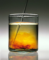 DISSOLUTION OF IODINE SPEEDED BY STIRRING (2 of 3)<br /> The Glass Rod In Jar Has Stirred The Solution.