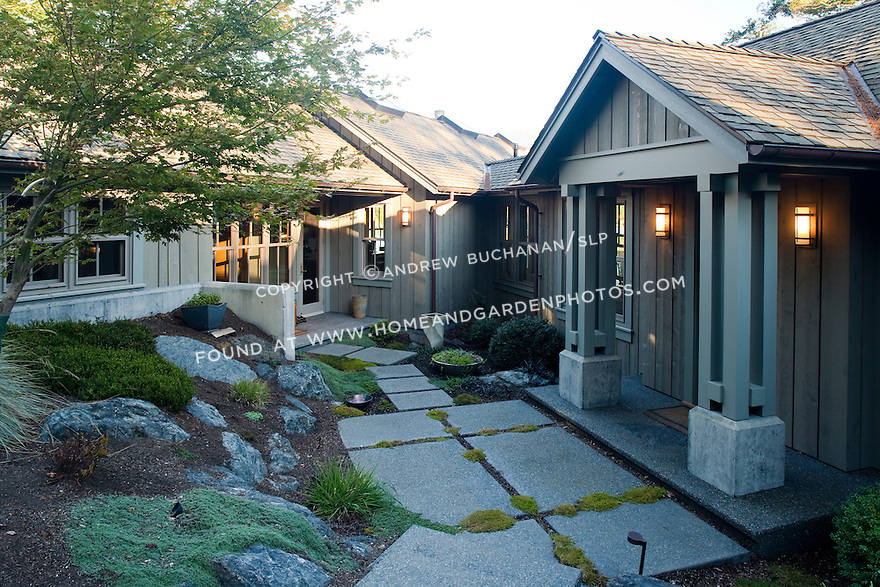 Stone pavers lead to the two entrances of this Pacific Northwest home. this image is available through an alternate architectural stock image agency, Collinstock located here: http://www.collinstock.com