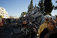 Tunis, January 15, 2011.The morning after the regime collapsed, people in the Krame neighborhood gather around the smoking carcasses of new cars stolen overnight from warehouses belonging to the Ben Ali-Trabelsi clan.