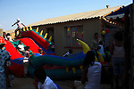 SOWETO, SOUTH AFRICA DECEMBER 16: Children play on a jumping castle during a birthday celebration on December 16, 2006 in Jabulani area of Soweto, Johannesburg, South Africa. Most birthdays for children have these jumping castles where the children play, and it usually takes up the whole garden. Soweto is South Africa?s largest township and it was founded about one hundred years to make housing available for black people south west of downtown Johannesburg. The estimated population is between 2-3 million. Many key events during the Apartheid struggle unfolded here, and the most known is the student uprisings in June 1976, where thousands of students took to the streets to protest after being forced to study the Afrikaans language at school. Soweto today is a mix of old housing and newly constructed townhouses. A new hungry black middle-class is growing steadily. Many residents work in Johannesburg, but the last years many shopping malls have been built, and people are starting to spend their money in Soweto. .(Photo by Per-Anders Pettersson/Getty Images)..