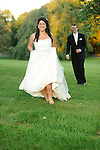 A beautiful Iranian-American bride, Zheila, runs barefoot on the lawn of the Tarrytown House in the Hudson Valley.