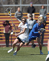 Boston College midfielder Kate McCarthy (20) on the attack as Duke University midfielder Chelsea Landon (7) defends.Boston College (white) defeated Duke University (blue), 10-9, on the Newton Campus Lacrosse Field at Boston College, on April 6, 2013.