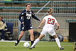 03 December 2010: Notre Dame's Courtney Barg (13) is defended by Ohio State's Lauren Steuer (23). The Notre Dame Fighting Irish defeated the Ohio State University Buckeyes 1-0 at WakeMed Stadium in Cary, North Carolina in an NCAA Women's College Cup semifinal game.