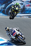 "Factory Yamaha rider Jorge Lorenzo of Spain leads Monster Yamaha rider Cal Crutchlow of Great Britain through the, ""Corkscrew,"" during Qualifying practice for U.S. MotoGP at Mazda Raceway Laguna Seca, Saturday, July 28, 2012."