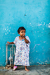 A young 2-5 year old Wayuu indigenous girl outside her home in a low-income neighborhood of Uribia, La Guajira, Colombia.
