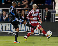 Santa Clara, California - Saturday July 18, 2012: FC Dallas' Brek Shea taps the ball away from San Jose Earthquakes' Victor Bernardez during a game at Buck Shaw Stadium, Stanford, Ca   San Jose Earthquakes defeated FC Dallas 2 - 1.