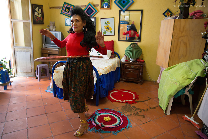 Norma Angelica, a resident of Casa Xochiquetzal, twirling a hula hoop in her bedroom at the shelter in Mexico City, Mexico on February 6, 2017. Casa Xochiquetzal is a shelter for elderly sex workers in Mexico City. It gives the women refuge, food, health services, a space to learn about their human rights and courses to help them rediscover their self-confidence and deal with traumatic aspects of their lives. Casa Xochiquetzal provides a space to age with dignity for a group of vulnerable women who are often invisible to society at large. It is the only such shelter existing in Latin America. Photo by Bénédicte Desrus
