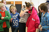 """Drama group for 8-13s run by Yvonne Arnaud Theatre, rehearsing a production of """"Alice"""" in a school hall, Guildford, Surrey."""