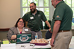 Diana McGew, Assistant Director of Strategic Sourcing and Operations for Procurement Services, left, and Richie Dillinger, <br /> Interim Contract Coordinator speak to someone at the Procurement Services booth at the Campus Communicator Network Expo in Nelson Commons on Wednesday, May 11, 2016. &copy; Ohio University / Photo by Kaitlin Owens