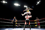 Lucha Libre AAA wrestler Mascarita Sagrada leaps onto Abismo Negroat a match in Sacramento, CA March 28, 2009.
