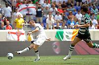 Robert Keane (10) of Tottenham Hotspur F. C. shoots and scores during a Barclays New York Challenge match against Sporting Clube de Portugal at Red Bull Arena in Harrison, NJ, on July 25, 2010.