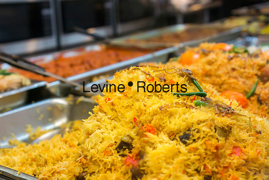 Rice dishes in a  buffet in an Indian restaurant in the Jackson Heights neighborhood of Queens in New York on Saturday, November 22, 2014. Besides a growing Tibetan community,  Jackson Heights is a polyglot of ethnicities including Indians, Pakistanis, Southeast Asian and long-time Jewish, Irish and Italian residents.  (© Richard B. Levine)
