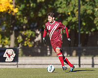 Boston College midfielder Giuliano Frano (15) brings the ball forward. Boston College (maroon) defeated Virginia Tech (Virginia Polytechnic Institute and State University) (white), 3-1, at Newton Campus Field, on November 3, 2013.
