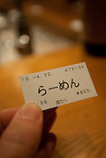 "A ticket which reads ""Ramen"" in Japanese hiragana alphabet, used to purchase ramen noodles inside the  'Watanabe' ramen noodle restaurant ( a restaurant selling fish-stock broth ramen noodles) in Takadanobaba district of Tokyo, Japan, Friday 30th April 2010."