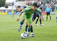 Fredy Montero (front) battles against Ramiro Corrales. The Seattle Sounders defeated the San Jose Earthquakes 1-0 in the second annual Heritage Cup at Buckshaw Stadium in Santa Clara, California on July 31st, 2010.