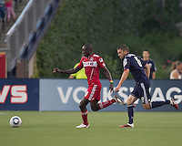 Chicago Fire forward Dominic Oduro (8) on the attack as New England Revolution midfielder Chris Tierney (8) closes. In a Major League Soccer (MLS) match, the New England Revolution tied the Chicago Fire, 1-1, at Gillette Stadium on June 18, 2011.