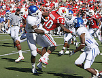 UK's Danny Trevathan tackles Louisville's Victor Anderson at Papa John's Cardinal Stadium on Saturday, Sept. 4, 2010. Photo by Scott Hannigan | Staff