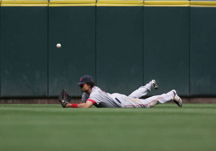 27 June 2007: Red Sox outfielder Coco Crisp dives for the ball during the Seattle Mariners vs Boston Red Sox at Safeco Park in Seattle, Washington.