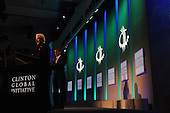 Former United States President Bill Clinton, left, introduces U.S. President Barack Obama, at the Clinton Global Initiative gathering Wednesday, September 21, 2011 at the Sheraton New York Hotel and Towers in New York, New York..Credit: Aaron Showalter / Pool via CNP