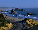 Cape Sebastian State Park Southern Oregon Coast Highway 101 at sunset looking south from viewpoint above coastline with rock formations and beach Oregon State USA