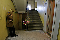 Moscow, Russia, 08/10/2006.&amp;#xA;A mourner at the entrance to the apartment lift where Anna Politovskaya, Novaya Gazyeta journalist, was shot to death in an apparent contract killing believed to be connected with her work.<br />