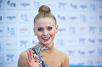 """September 09, 2015 - Stuttgart, Germany - JAZZY KERBER  of USA waves from """"kiss & cry"""" during AA qualifications at 2015 World Championships."""