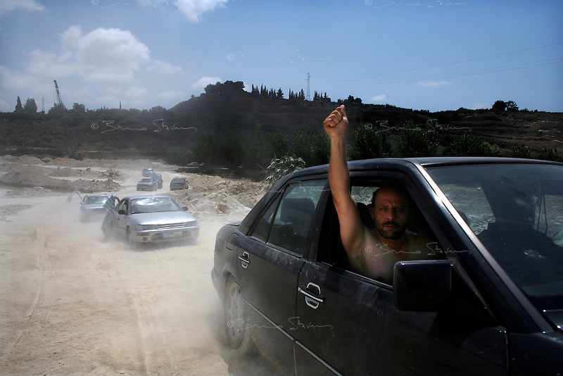 South Lebanon, July 21, 2006.Ten of thousands of refugees leave their homes and villages under the israeli bombardment to try and reach a relative safety in Beirut, in the montains or for the priviledged, abroad.