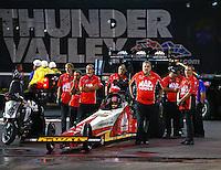 Jun 17, 2016; Bristol, TN, USA; Crew members with NHRA top fuel driver Doug Kalitta during qualifying for the Thunder Valley Nationals at Bristol Dragway. Mandatory Credit: Mark J. Rebilas-USA TODAY Sports