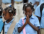 Girls pray at the start of the school day in Batey Bombita, a community in the southwest of the Dominican Republic whose population is composed of Haitian immigrants and their descendents.