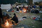 PRIMROSE, SOUTH AFRICA - MAY 23: African refugees warm themselves on open fires outside their tents on May 23, 2008 at Primrose police station outside Johannesburg, South Africa. They were chased out with other African immigrants and many shacks were burned down during xenophobic attacks in the township. A man was burned alive down the street and thousands of people fled to a nearby police station for safety. South Africa was hit by xenophobic attacks that killed about sixty people and displaced tens of thousands. (Photo by: Per-Anders Pettersson/Getty Images).