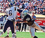 Oakland Raiders vs. San Diego Chargers at Oakland Alameda County Coliseum Sunday, September 3, 2000.  Raiders beat Chargers  9-6.  Oakland Raiders linebacker William Thomas (59) sacks San Diego Chargers quarterback Ryan Leaf (16).