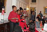 Actress and singer Rhonda Ross (Another World) and son Raif - Hearts of Gold links to a better life celebrates Christmas with a party #2 for mothers and their children on December 17, 2016 in New York City, New York with arts and crafts, a great turkey dinner with all the goodies and then the children met Santa Claus and had a photo with him as he gave them gifts. (Photo by Sue Coflin/Max Photos)