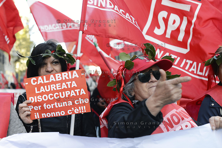 Roma, 25 Ottobre 2014<br /> Lavoro. La CGIL manifesta a Roma con due cortei nazionali fino a Piazza San Giovanni , contro il jobs act e la riforma dell'art.18 del governo Renzi.<br /> <br /> CGIL protest against the jobs act and the reform of article 18 of the government Renzi.<br /> <br /> Rome, October 25, 2014 <br /> Work. The national union CGIL manifested in Rome with two national marches to Piazza San Giovanni, against the jobs act and the reform of article 18 of the government Renzi.