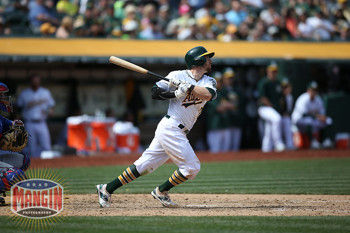 OAKLAND, CA - APRIL 9:  Eric Sogard #28 of the Oakland Athletics bats against the Texas Rangers during the game at O.co Coliseum on Thursday, April 9, 2015 in Oakland, California. Photo by Brad Mangin