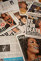 A collection of New York City newspaper covers over several days relating to the death of the singer Whitney Houston on Saturday, February 11, 2012. (© Richard B. Levine)