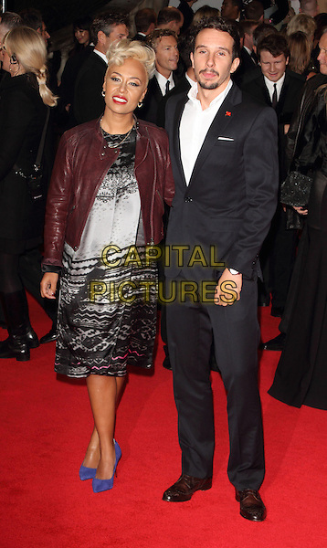 Emeli Sande and Adam Gouraguine.Royal World Premiere of 'Skyfall' held at the Royal Albert Hall, London, England..October 23rd, 2012.full length maroon leather jacket grey gray black print dress blue shoes suit white shirt married husband wife .CAP/ROS.©Steve Ross/Capital Pictures.