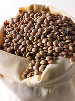 Whole Brown Lentils Beans - stock photos