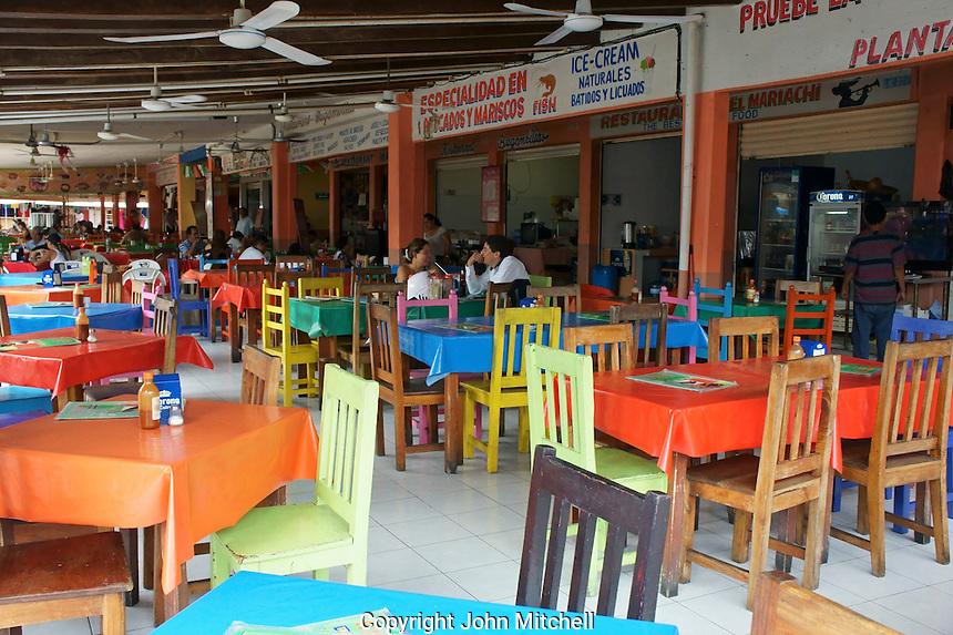 Seafood restaurants in Mercado 28 souvenirs and handicrafts market in  Cancun, Mexico      .