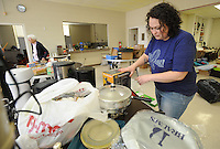 NWA Democrat-Gazette/ANDY SHUPE<br /> Autumn Anderson of Fayetteville volunteers time Friday, Feb. 10, 2017, to organize items for a rummage sale to benefit Cooperative Emergency Outreach in the Fellowship Hall at Rolling Hills Baptist Church. The Quaker Meeting is hosting the sale from 8 a.m. to 1:30 p.m. today to benefit the CEO which has provided emergency assistance to residents of Washington County for 27 years through its association with approximately 20 area churches.