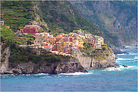 The small fishing village of Manarola in the Cinque Terre rests peacefully above the Mediterranean Sea. This picture of the amazing Cinque Terre was taken from the village of Corniglia and looks across the water (called the Ligurian Sea).  ..If you ever have the opportunity, the hike between the five towns of the Cinque Terre is well worth the effort and time. Take your time, enjoy the different character and offerings of each town, and make memories that will last a lifetime.