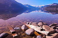 view of beautiful Slocan Lake, within the Selkirk Mountain Range, in the West Kootenay region of British Columbia, old train tracks in the water